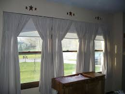 White Fabric Window Curtains On The Hook Connected By Glass Windows