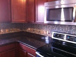 finished our backsplash tan brown granite dark cherry cabinets