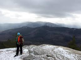 Hiker And Stormy View From The South Cliffs Of Iron Mountain In New Hampshire