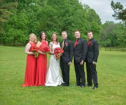 The Guys Wore Classic Black Suits And Alexander A Gold Vest Tie While Groomsmen Red