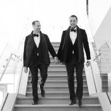 Classic Black Tux Groom Style With Bow Tie