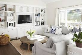 living room features a dove grey sectional with rolled arms and a