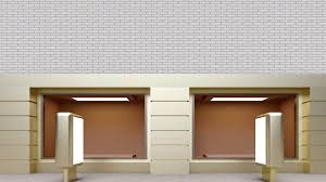 Golden Empty Shop Window Against A White Brick Wall
