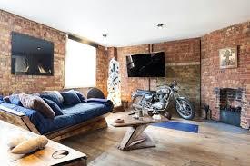 wandgestaltung im wohnzimmer unbehandelte ziegelwand