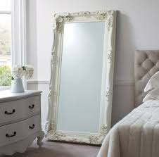 Leaner Mirror With White Frame Before The Wall Plus Dresser And Bedding For