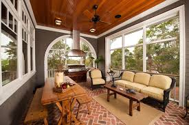 Rustic Sunroom Decorating Ideas Traditional With Grey Siding Wood Coffee Table Bench