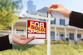 Download Sold Sign And Agent Handing Over Keys To New Home Stock Photo
