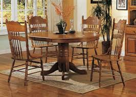 5 piece 42 inch round oval dining set with press back chairs in