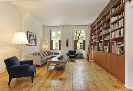 Rustic Living Room With Hardwood Floors Built In Bookshelf West Elm Peggy Mid