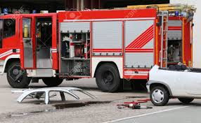 100 Fire Truck Accident Road With White Car Parts And The Truck Stock Photo