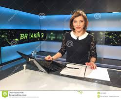 Download TV Reporter At The News Desk Stock Image
