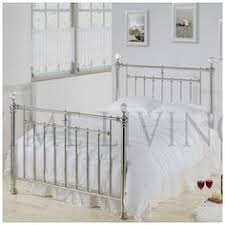 jemima metal bed in white metal bed with four large plastic