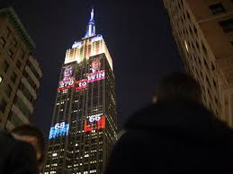 The Empire State building is lighting up to display election night