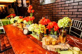 Encore Centerpieces Orange Yellow Flowers In Rustic Containers