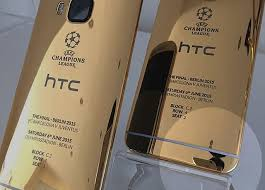 Oops HTC Unveils its 24K Gold e M9 with a Taken with an iPhone