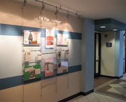 Poster Displays With Easy Access Acrylic Pockets Wall Mounted On 6mm Rod Display System