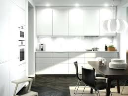 White Kitchen Black Appliances A With And Brown Leather Chairs