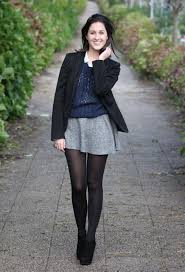 Thats A Retro Inspired Outfit We See Cute Gray Mini Skirt Teamed With Blue Perforated Sweater White Blouse And Black Blazer