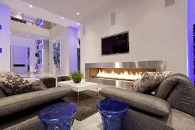 Interior White Themes Living Room With Grey Electric Fireplace And Leather Sofa Also