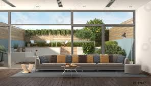 foto auf lager wohnzimmer einer modernen villa mit garten im hintergrund