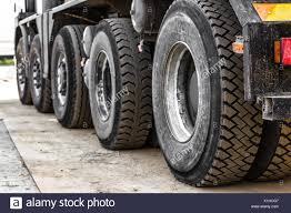 Row Of Rubber Semi-Truck Tires Stock Photo: 276363591 - Alamy Semi Truck Tires For Sale In Charleston Sc Awesome New 2018 Dodge Mtaing Stock Photo Welcomia 173996234 Services World Twi Questions About Commercial Answered At Bestteandrvrepaircom Bfgoodrich Launches Smartwayverified Drive Tire News Used For Chinese Whosale Cheap Heavy Duty Radial 11r245 11r Closeup Damaged 18 Wheeler Edit Now Retread Laredo Tx Tractor Trailer Tire Service Jc China 180kmiles Timax Super Single Fenders Minimizer Rc4wd Roady 17 114 Rc4zt0032 Rock Crawlers