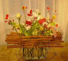 Floral Arrangement Made With Metal Wire And Wooden Pieces
