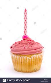 pink cupcake with candle on a white background