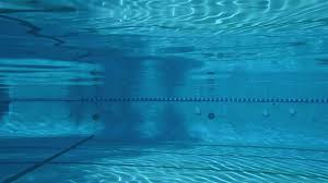 Underwater View Of Girl Jumping Into A Pool And Swimming In Ojai California Stock Video Footage