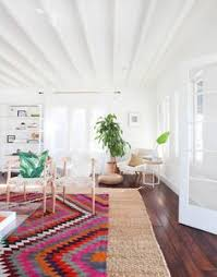 idea layer a colorful rug over a neutral one