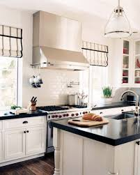 Classic White Kitchen Cabinets With Black Countertops