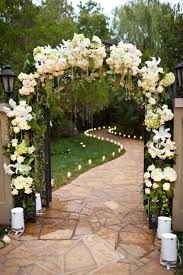 Wedding Ceremony Arch Decorated With White Flowers