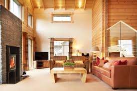Brown Couch In Rustic Living Room With Sofa And Coffee Table Also Glass Railing Log Burning Stove Plus Open Plan Lamps Tall