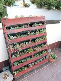 A Vertical Pallet Planter Propped Against Wall