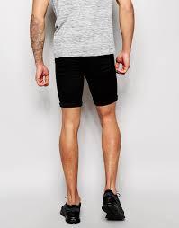 asos denim shorts in extreme super skinny fit mid length in black