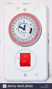 water boiler switch with timer and pilot light on a wall