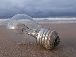the light bulb on sand in the stock photo image 80380366