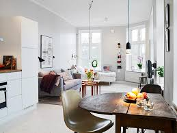 Small Apartment In Gothenburg Showcasing An Ingenious Layout Shop This Look Table Couch Nesting Tables
