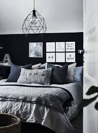 a bedroom decorated in grey black and blue