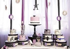 Black and white and a hint of pink this sweet table wows guests with the selection of cakes in an assortment of black and white designs