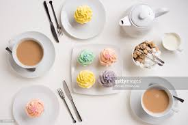Table Place Setting With English Tea And Cupcakes Stock Photo