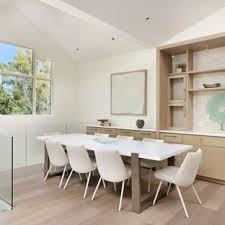 Example Of A Trendy Light Wood Floor And Beige Dining Room Design In Denver With