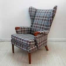 checkered wingback chair with teak legs from knoll 1960s