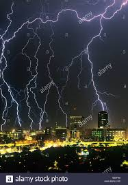 Lightning Storm Thunderstorm Over Downtown Tucson Arizona USA With Large Lighting Bolts In The City