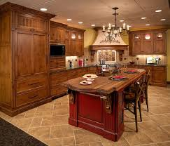 Good Looking Tuscan Kitchen Decoration With Red Wood Island Along Light Walnut Cabinet And Cream Porcelain Tile Flooring