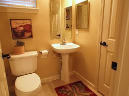 Guest Bathroom Wall Decor With Framed Painting Above Toilet Under Small Window Full Size