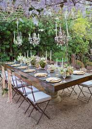 Pergola Wisteria Blooms Chandeliers Taper Candles Matching Chairs And Dark Brown Wooden Table For The Backyard