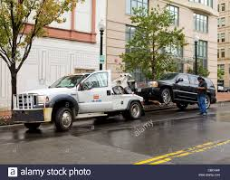 An SUV Hitched To A Wheel-lift Tow Truck - USA Stock Photo ... 2007 Chevy 2500 Hd Repo Truck Tow Self Loading Wheel Llift Legacy F750 003_1488668105__5193jpeg Towing Can A Tow Truck You And Your Trailer Motor Vehicle Dg Towing Equipment About Us Nyc Boa Hidealift Monza 1000z Company In Fort Lauderdale Fl Monster Recovery Trucks Kgwcom Salem Company Accused Of Excessive Fees Skirting