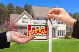 Download Realtor Handing Over The House Keys In Front Of New Home Stock Photo