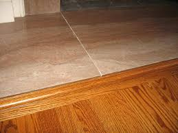 install transition wood to tile cabinet hardware room