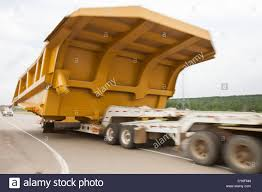 Trucks Haul An Oversize Load, A Massive Dump Truck Used In The Tar ... Peterbilt Dump Trucks Sale California Truck For Used Heavy Equipment For Sale List Manufacturers Of Isuzu Elf Buy 2018 Freightliner 122sd Quad With Rs Body Triad Dump Trucks 2011 Kenworth T800 Utah Nevada Idaho Dogface Equipment Mack 741 Listings Page 1 30 Tokyo Truck Show Tokyo Tom Baker The Blog Hemmings Find The Day 1952 Reo Daily Opdyke Inc Picture 27 50 Landscape Elegant Debary